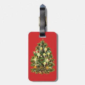 ろうそくに照らされたクリスマスツリーは花輪を飾ります ラゲッジタグ