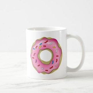 アイシングが付いているおいしいドーナツは振りかけ、 コーヒーマグカップ