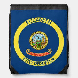 アイダホの宝石の州の名前入りな旗 ナップサック