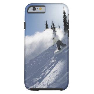 アイダホの粉を裂いているオスのスノーボーダー ケース