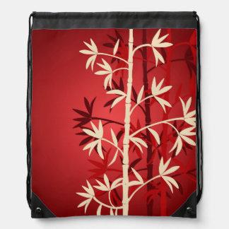 アイボリーおよび赤いタケ木のバックパック ナップサック