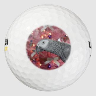 アフリカ灰色のオウムおよびSnowyのピンクのクリスマスツリー ゴルフボール