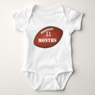 アメルのフットボールベビーの写真のための11か月のベビーのワイシャツ ベビーボディスーツ