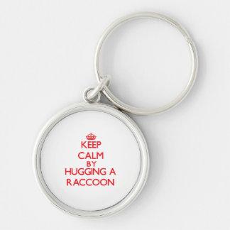 アライグマを抱き締めることによって平静を保って下さい キーホルダー