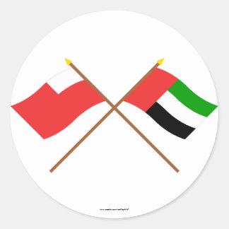 アラブ首長国連邦およびアブダビによって交差させる旗 ラウンドシール