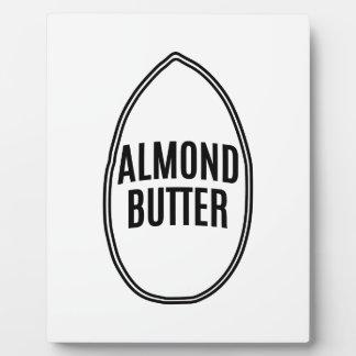 アーモンドの中のアーモンドのバター フォトプラーク