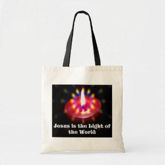 イエス・キリストは世界の赤の蝋燭のライトです トートバッグ
