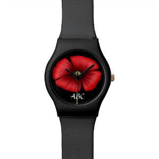 イニシャルの腕時計を持つ独身ので赤いケシ 腕時計