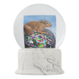 イースターのための多彩な卵のウサギ- 3Dは描写します スノーグローブ