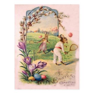 イースターのウサギの着色された色彩の鮮やかな卵のテニス ポストカード