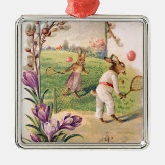 イースターのウサギの着色された色彩の鮮やかな卵のテニス メタルオーナメント