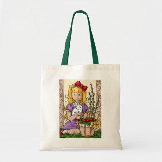 イースターのウサギを持つかわいい小さな女の子 トートバッグ
