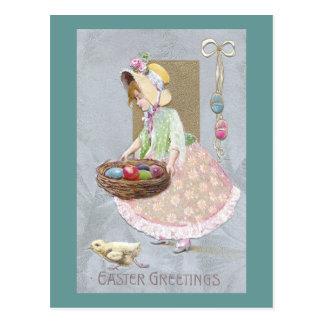 イースターエッグのヴィンテージの巣を持つ女の子 ポストカード