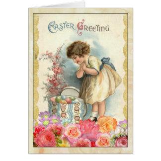イースターエッグのヴィンテージの挨拶状を持つ若い女の子 カード
