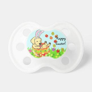 イースターエッグの黄色のラブラドールの子犬の漫画 赤ちゃんおしゃぶり