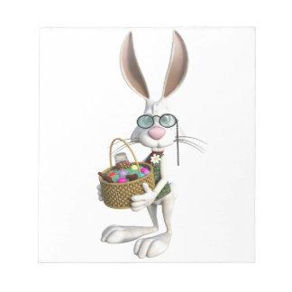 イースターバスケットが付いているイースターウサギ ノートパッド