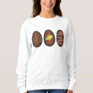 イースターバスケットキャンデーのチョコレートの卵はスエットシャツに卵を投げつけます スウェットシャツ
