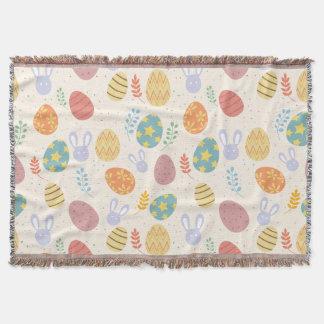 イースター投球毛布のバニーはパターンに卵を投げつけます スローブランケット