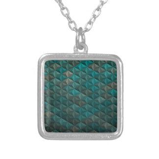 エメラルドグリーンのティール(緑がかった色)の幾何学的なパターン シルバープレートネックレス