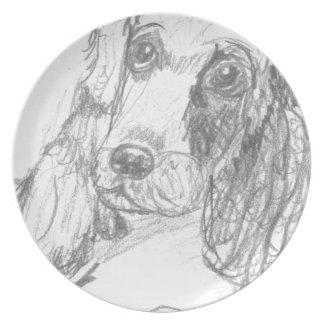 エリアナを引いているコッカースパニエル犬 プレート