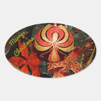 エレガントで赤い金ゴールドのクリスマスのオーナメントのポインセチア 楕円形シール