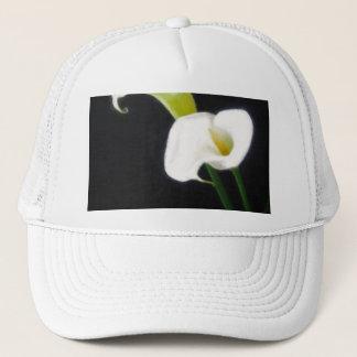 エレガントなオランダカイウユリによっては絵画的な1つが開花します キャップ