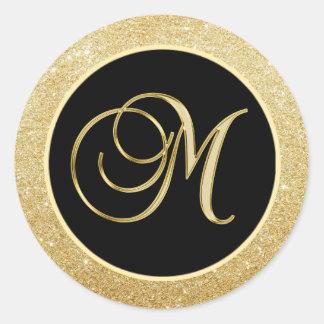 エレガントなモノグラムの手紙Mの黒い金ゴールドのグリッターのシール ラウンドシール