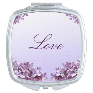 エレガントな薄紫のコンパクトの鏡