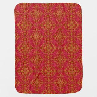 エレガントな金ゴールドおよび濃いピンクの花のダマスク織パターン ベビー ブランケット