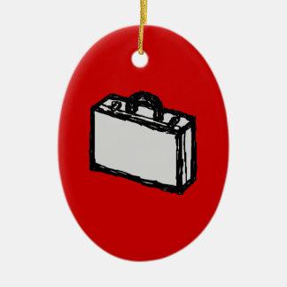 オフィスのブリーフケースか旅行スーツケース。 スケッチ。 赤い セラミックオーナメント