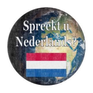 オランダを話しますか。 オランダ。 旗及び地球 カッティングボード