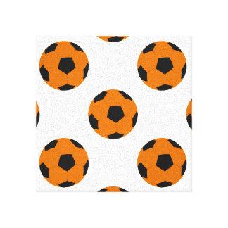 オレンジおよび黒いサッカーボールパターン キャンバスプリント