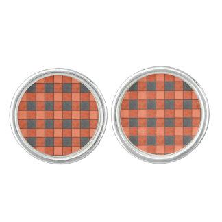 オレンジおよび黒い格子縞の点検のカフスボタン カフスボタン