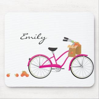 オレンジが付いているショッキングピンクの自転車 マウスパッド