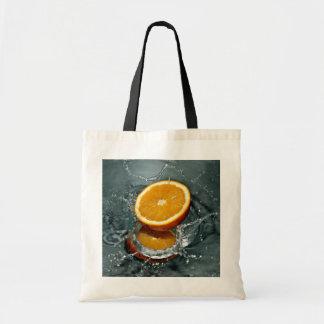 オレンジしぶきのバッグ トートバッグ