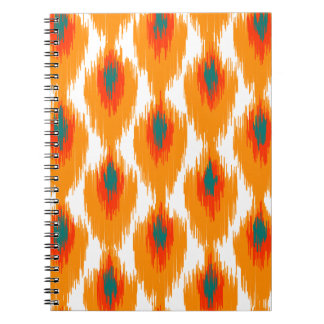 オレンジティール(緑がかった色)の抽象芸術の種族のイカットのダイヤモンドパターン ノートブック