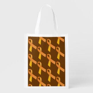 オレンジリボンはパターンをタイルを張りました エコバッグ