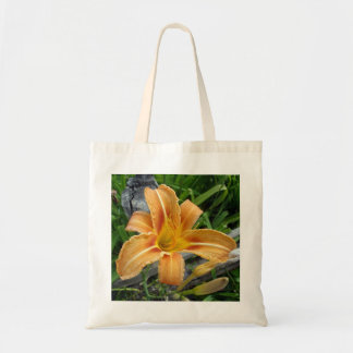 オレンジワスレグサトラユリの花が付いている綿のバッグ トートバッグ
