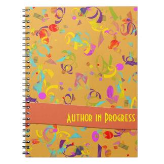 オレンジ上のカラフルな紙吹雪のトスの背景 ノートブック