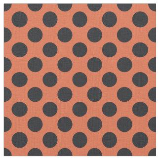 オレンジ及び黒い水玉模様の生地 ファブリック