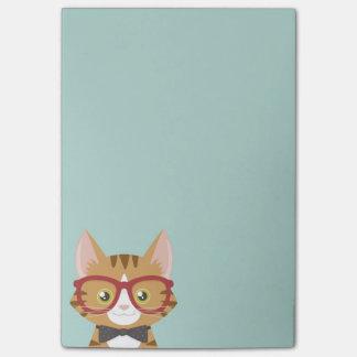 オレンジ虎猫のヒップスター猫は後it®ノートをからかいます ポストイット