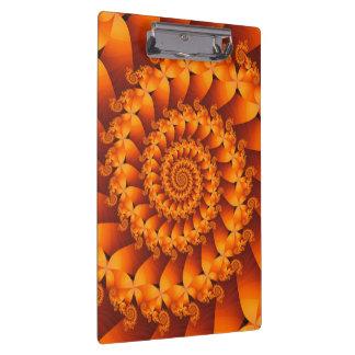 オレンジ螺線形のクリップボード クリップボード