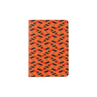 オレンジ赤および黒のパスポートのホールダー パスポートカバー