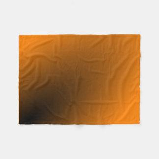 オレンジ黒い勾配 フリースブランケット