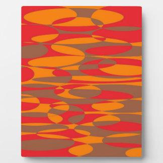 オレンジ、赤いおよび茶色の楕円のデザイン フォトプラーク