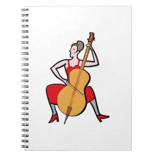 オーケストラのベース奏者の女性の赤dress.png ノートブック