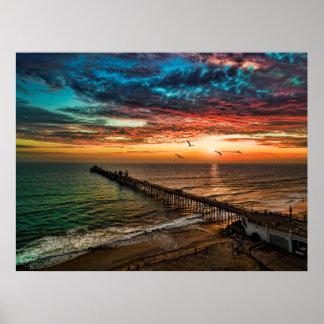 オーシャンサイド桟橋の近くの日没 ポスター
