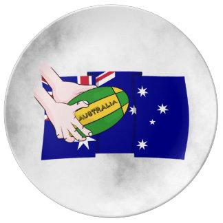 オーストラリアの旗のラグビーのボールの漫画手 磁器プレート
