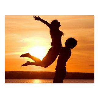 カップル愛のビーチの日没 ポストカード