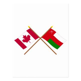 カナダおよびオマーンによって交差させる旗 ポストカード
